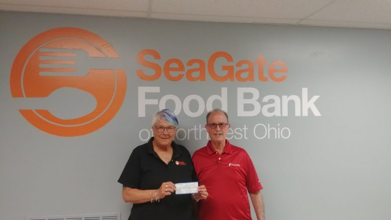 Mr. Dannhauser from FocusCFO came in today to present us with a generous donation that wil...